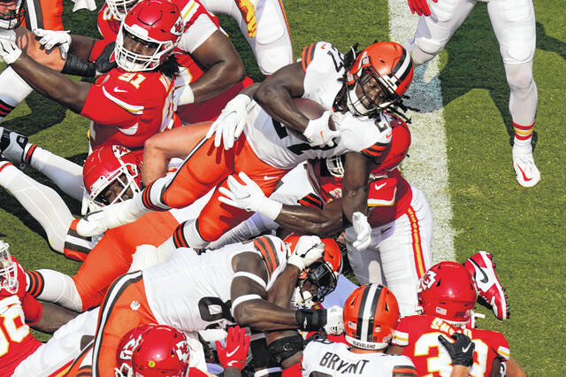 Cleveland Browns running back Kareem Hunt (27) scores a 2-point conversion during the first half of an NFL football game against the Kansas City Chiefs Sunday in Kansas City, Mo.