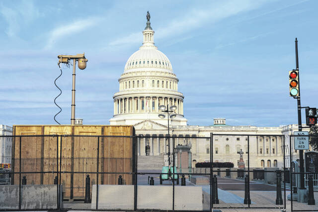 Security fencing and video surveillance equipment have been installed around the Capitol in Washington on Thursday, Sept. 16, 2021, ahead of a planned Sept. 18 rally by far-right supporters of former President Donald Trump who are demanding the release of rioters arrested in connection with the 6 January insurrection.