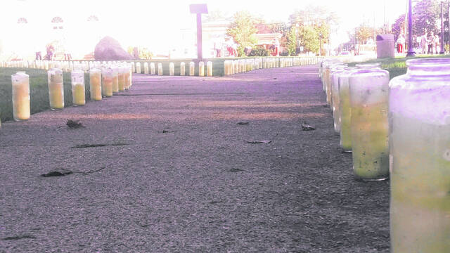 White candles line the paths on Tallmadge Circle on Saturday, one for each victim of the 9/11 attacks.