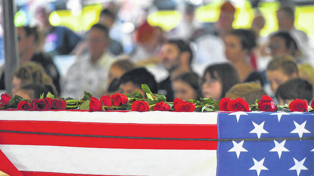 A coffin carrying the names and photos of the men and women who died on 9/11 was on display during the ceremony at First Missionary Church.