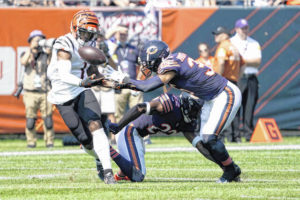 Fields takes over for injured Dalton, Bears beat Bengals
