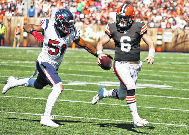 Cleveland Browns quarterback Baker Mayfield (6) scrambles away from Houston Texans outside linebacker Kamu Grugier-Hill (51) during the second half of an NFL football game, Sunday in Cleveland.