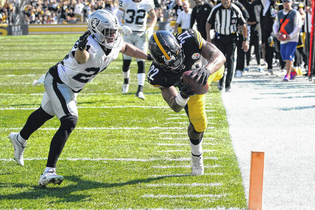 Pittsburgh Steelers running back Najee Harris (22) dives into the end zone with Las Vegas Raiders defensive back Johnathan Abram (24) defending for a touchdown during the second half of an NFL football game in Pittsburgh, Sunday.