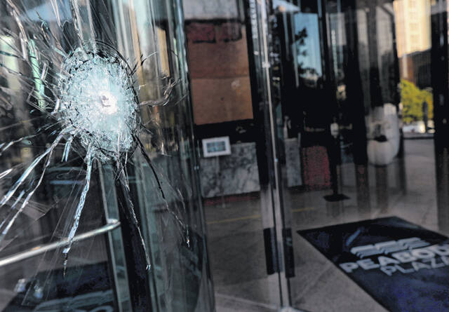 A view of a broken window is shown on Tuesday, September 7, 2021, at Peabody Plaza, located at 701 Market Street in St. Louis. An investigation is underway to determine if the damage was caused by gunfire over the Labor Day weekend. Several windows were broken.