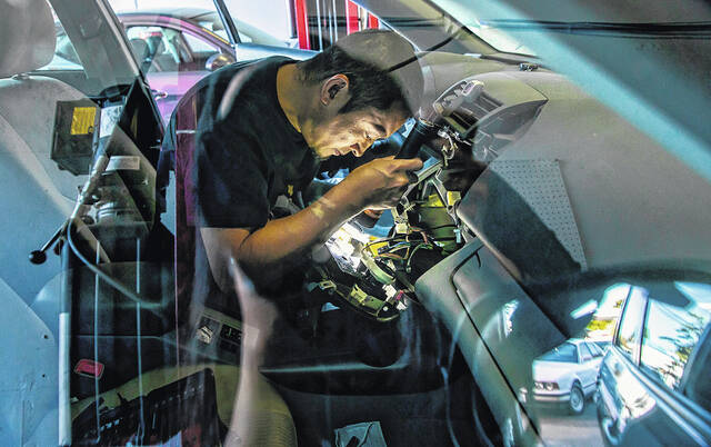 Jakob Lorz is the owner of Lorz Automotive in Seattle's Rainier Valley, an auto repair shop he opened earlier this March. A shortage of skilled car mechanics has him working solo 12-hour days, six or more days per week, to meet demand.