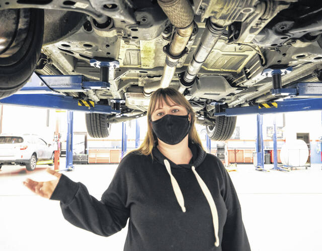 Amber Avery is an instructor in the Shoreline Community College automotive program. Standing below a late model Chevrolet that was donated to the program, she talks to us about Seattle's next labor crunch: the people who fix your car.