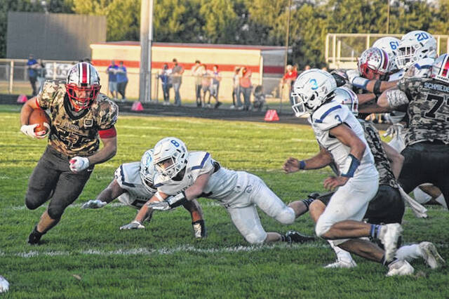 Columbus Grove running back Collin Metzger finds a hole during Friday night's home game against Allen East.