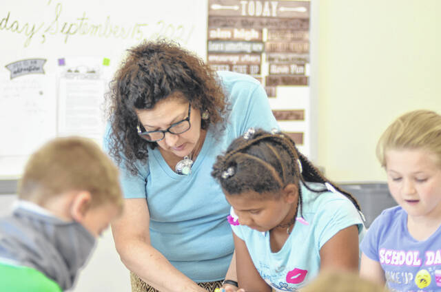 Vickie Schafter, a third-grade teacher at Elida Elementary, works with student Jaéhana Battles. Elida schools is experimenting with direct literacy interventions to close the reading gap, a particular concern for third-graders who missed the end of their first grade year in 2020.