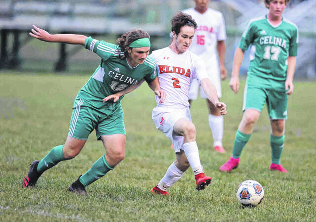 Elida's Ethan Thomas dribbles up field and Celina's Ramsey Cox is on defense at Celina high school Monday. No score was reported by press deadline. There are more photos are available at limaohio.com