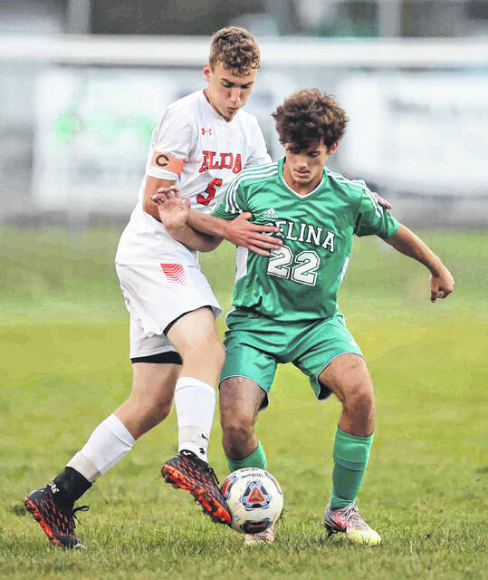 Elida's Austin Miller makes the steal from Celina's Mason Jefferies in the first half at Celina high school Monday. No score was reported by press deadline.