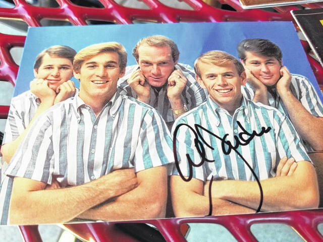 Justin Evans finally received autographed CD covers from Lima native and Beach Boy Al Jardine.