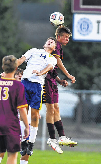 Kalida's Adam Siefker, right, heads the ball against Miller City's Ethan Barlage during Tuesday's match at Kalida.