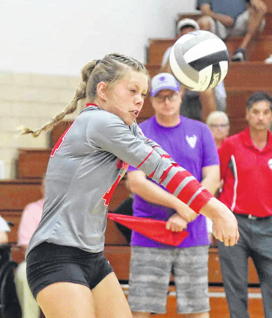 Columbus Grove's Brynn Fortman receives a Leipsic serve during Tuesday night's match at Leipsic.