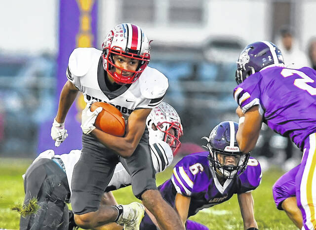 Columbus Grove's Trenton Barraza gains yardage during Friday night's game at Leipsic. See more high school football photos at LimaScores.com.