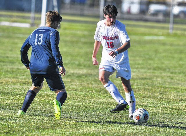 Temple Christian's Josiah Menke (13) defends against Lima Central Catholic's Max Gaumier during Thursday's match.