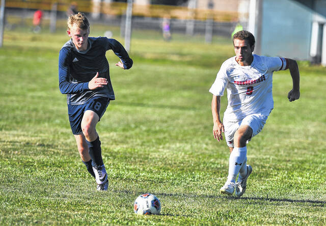 Temple Christian's Dawson Clay (18) and Lima Central Catholic's Brayden Truex try to beat each other to the ball during Thursday's match.