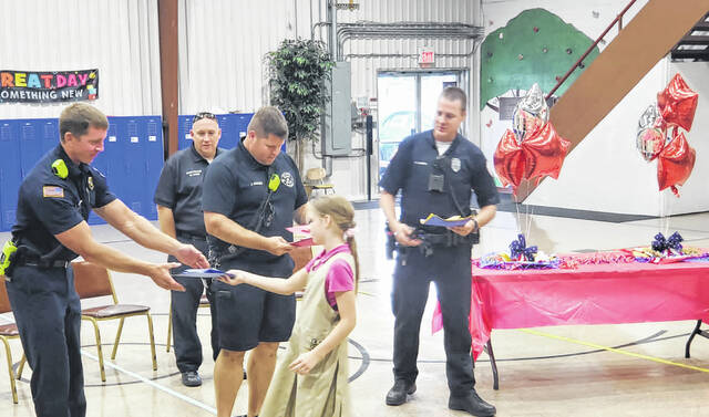 On Thursday afternoon, students at Bible Believers Christian School marked the 20th anniversary of 9/11 by sharing their appreciation for first responders from Shawnee Township Fire and Rescue and Shawnee Township Police Department. Attendees included fire captain Jeff Jones, fire protection officer Matt Myers, firefighter Josh Hodges and police patrolman Cody Warris.