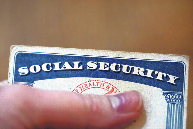 This Tuesday, Oct. 12, 2021, photo shows a Social Security card in Tigard, Ore. Millions of retirees on Social Security will get a 5.9% boost in benefits for 2022.
