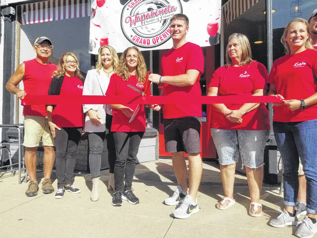 The Wiremans cut the ribbon Wednesday on the grand opening of the Krave Creamery in downtown Wapakoneta.