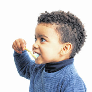 How can parents teach kids to properly brush their teeth?