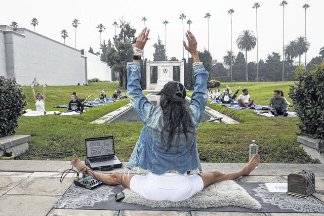 Monique Reymond holds a hypno-yoga class Sept. 8 on the grounds of Cathedral Mausoleum at Hollywood Forever Cemetery in Los Angeles, California.