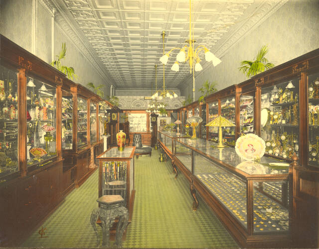 """A 1918 photograph shows the cases full of jewelry available at Hughes & Son Jewelry Co. at 135 N. Main St., Lima. The store touted itself as """"the Tiffany of Lima"""" in advertisements."""