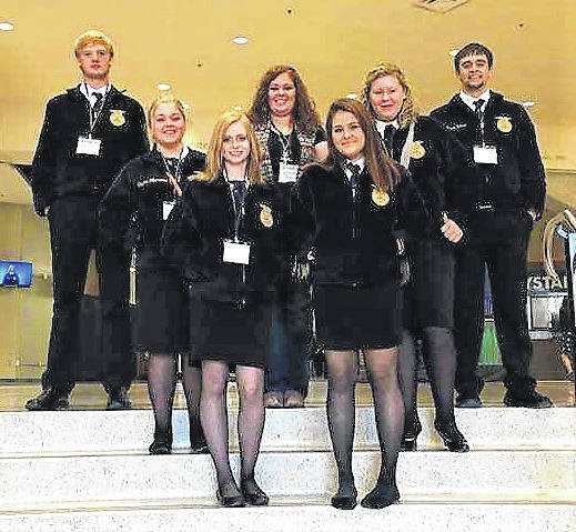 3991c7032a43 Agriculture teacher and FFA adviser Emily Anderson is flanked by Billy  Crabtree
