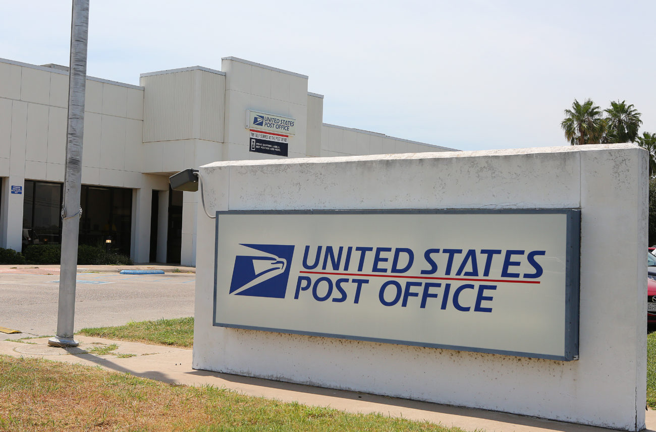 As US postmaster testifies to Senate, states sue over mail delays
